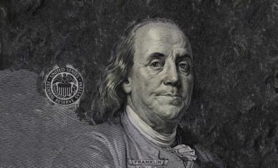Benjamin Franklin on copied blured background