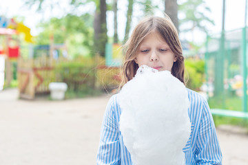 girl and cotton candy in the Park
