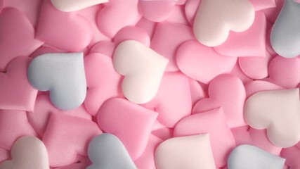 Fotoväggar - Valentine's Day. Holiday abstract pink Valentine background with satin hearts. Rotated heart shape top view. 4K UHD video footage. 3840X2160