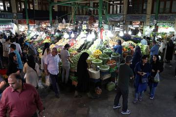 People buy fruits and vegetables from Tajrish Bazaar in Tehran