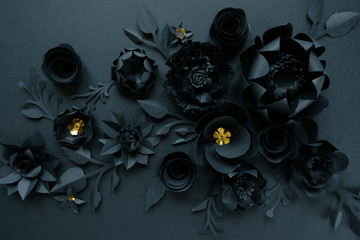 Black paper flowers on Black background. Cut from paper.