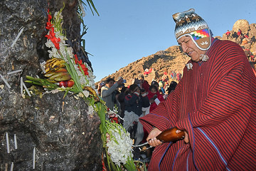 Bolivia's President Evo Morales gives an offering on the first day of ceremonies honoring the Pachamama (Mother Earth), in Pajchiri