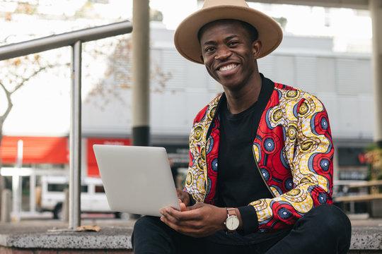 Smily man working on laptop
