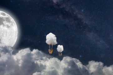manipulation picture of balloons fly over clouds with moon background, the dream concept.