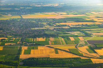 Aerial view of rural area and agricultural fields crossed by highways at sunset