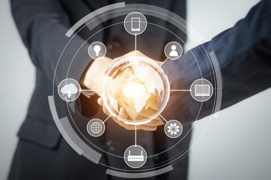 IOT. Internet of Thing concept. Handshake. Businessmen making handshake. Abstract of Business handshake. Polygonal mesh art. effect of technological innovation,