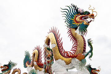 Chinese golden dragon statue isolated on white background.