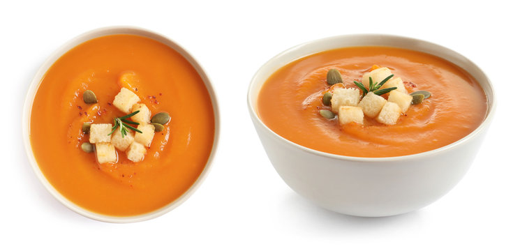 Fresh vegetable detox soup with croutons in dish on white background