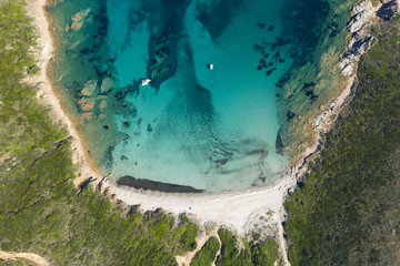 Wall Mural - View from above, stunning aerial view of a wild beach bathed by a beautiful turquoise sea. Costa Smeralda (Emerald Coast) Sardinia, Italy.
