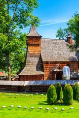 Fototapeta Old wooden church listed on Unesco list in Debno village on sunny summer day, Poland obraz