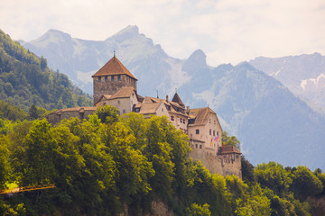 Liechtenstein Castle surrounded by Alps Mountains