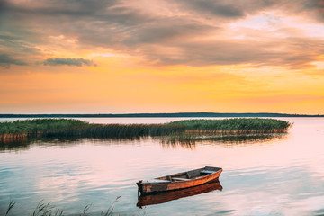Braslaw Or Braslau, Vitebsk Voblast, Belarus. Wooden Rowing Fishing Boat In Beautiful Summer Sunset On The Dryvyaty Lake. This Is The Largest Lake Of Braslav Lakes. Typical Nature Of Belarus