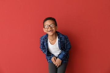 Laughing African-American boy on color background Wall mural