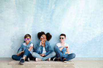 Stylish children in jeans clothes near color wall Fototapete
