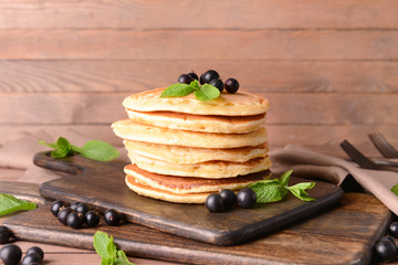 Tasty pancakes with berries on table Fototapete
