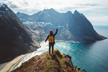 Man stand on cliff edge alone enjoying aerial view backpacking lifestyle travel adventure outdoor vacations Wall mural