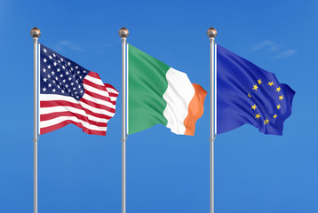 Three colored silky flags in the wind: USA (United States of America), EU (European Union) and Ireland. 3D illustration.