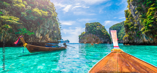 Wall mural Landscape with  longtail boat on Loh Samah Bay, Phi Phi island, Thailand