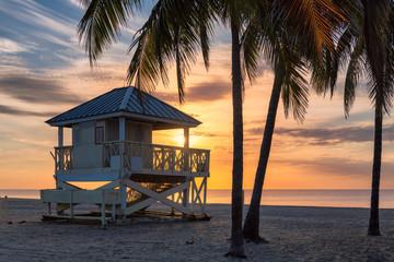Fototapete - Palm trees on Miami Beach at sunrise and life guard tower, South Miami Beach, Florida.