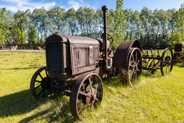 old and history tractor in a field