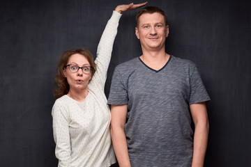 Shot of funny short woman and tall man