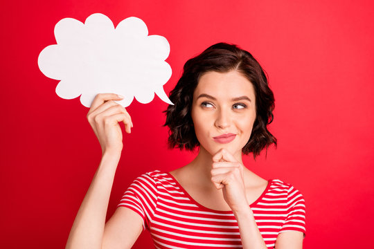 Photo of beautiful girl holding white cloud pretending to be thinking something over while isolated with red background