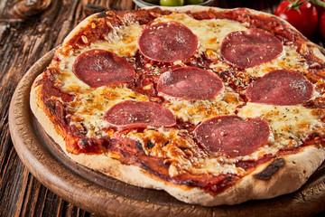 Tasty flame-grilled Italian salami pizza