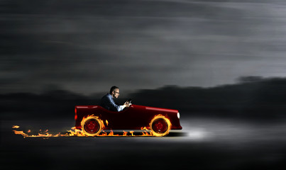 Businessman in a red car with flames Wall mural