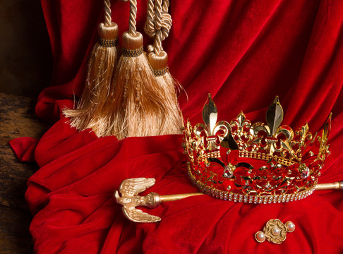 Scepter and crown on red velvet