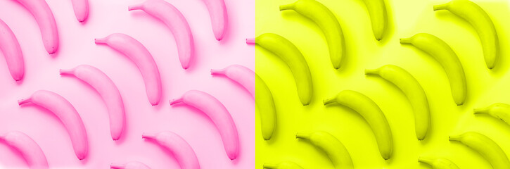 Chaotic colorful fruit pattern. Bananas over neon pink and yellow color background. Banner. Top view. Pop art design, creative summer concept. Minimal flat lay style.