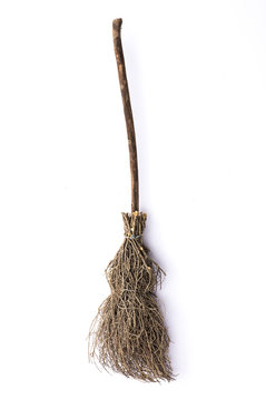 Old wicked witches broomstick isolated on white background, Halloween