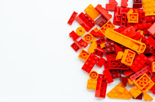 Red and Orange Educational Toys Bricks Blocks Top View isolated on White Background