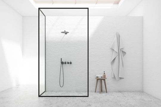 White bathroom interior with shower stall