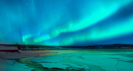 Poster de jardin Aurore polaire Northern lights (Aurora borealis) in the sky with super full moon - Tromso, Norway