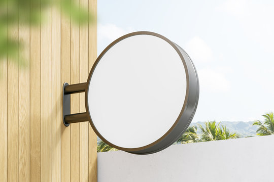 Round mock up sign on light wooden wall