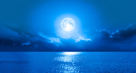 Wall Mural - Moon over the sea with lot of stars and nebula at night
