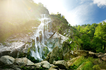 Majestic water cascade of Powerscourt Waterfall, the highest waterfall in Ireland. Tourist atractions in co. Wicklow, Ireland. Wall mural