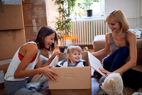 gay woman's with a toddler girl moving in new home.