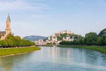 Salzburg skyline with Hohensalzburg Fortress and Salzach river in summer, Austria.