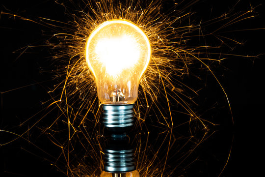 light bulb and sparkler in the dark