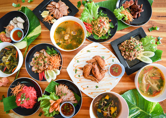 Thai food served on dining table / Tradition northeast food Isaan delicious on plate with fresh vegetables Many variety various Thai menu Asian food on a wooden table, top view Fototapete