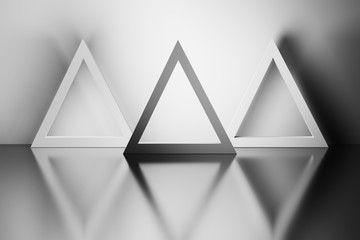 Monochrome image of three triangles in a room over reflective mirror surface. 3d illustration. Wall mural