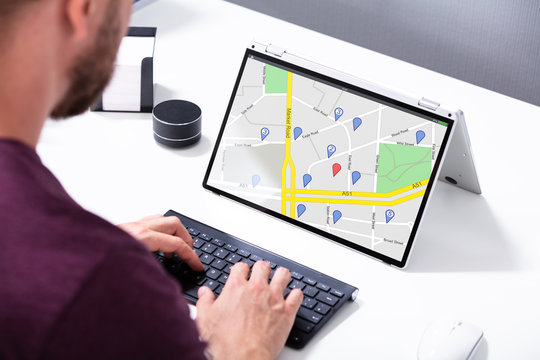 Man Browsing GPS Map On Laptop