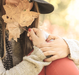 Young lady with leaf outdoor