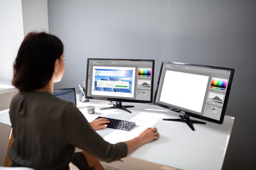 Designer Woman Working On Computer In The Office