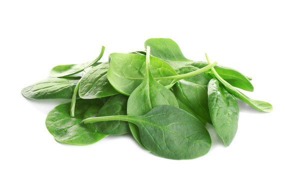 Pile of fresh green healthy baby spinach leaves on white background