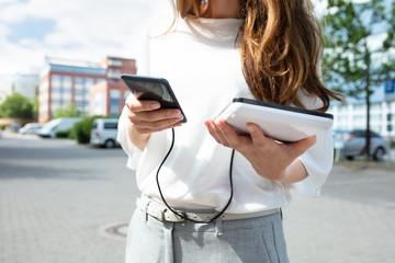 Woman Charging Mobile Phone