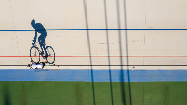 shadow of a cyclist training at a velodrome. preparation for professional competitions. Original shape top view