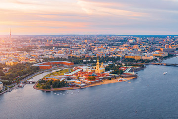 Aerial view panoramic of Peter and Paul cathedral at red sunset, walls of fortress, in Saint-Petersburg. Fototapete