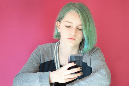 portrait of teenager with mobile phone